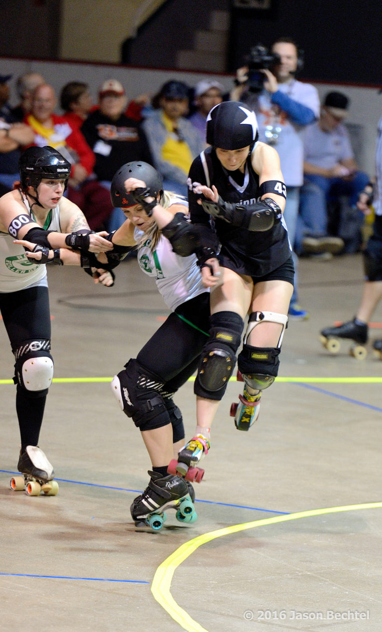 Wheezy jumps the apex during a 2016 Cincinnati Rollergirls game at the Cincinnati Gardens.